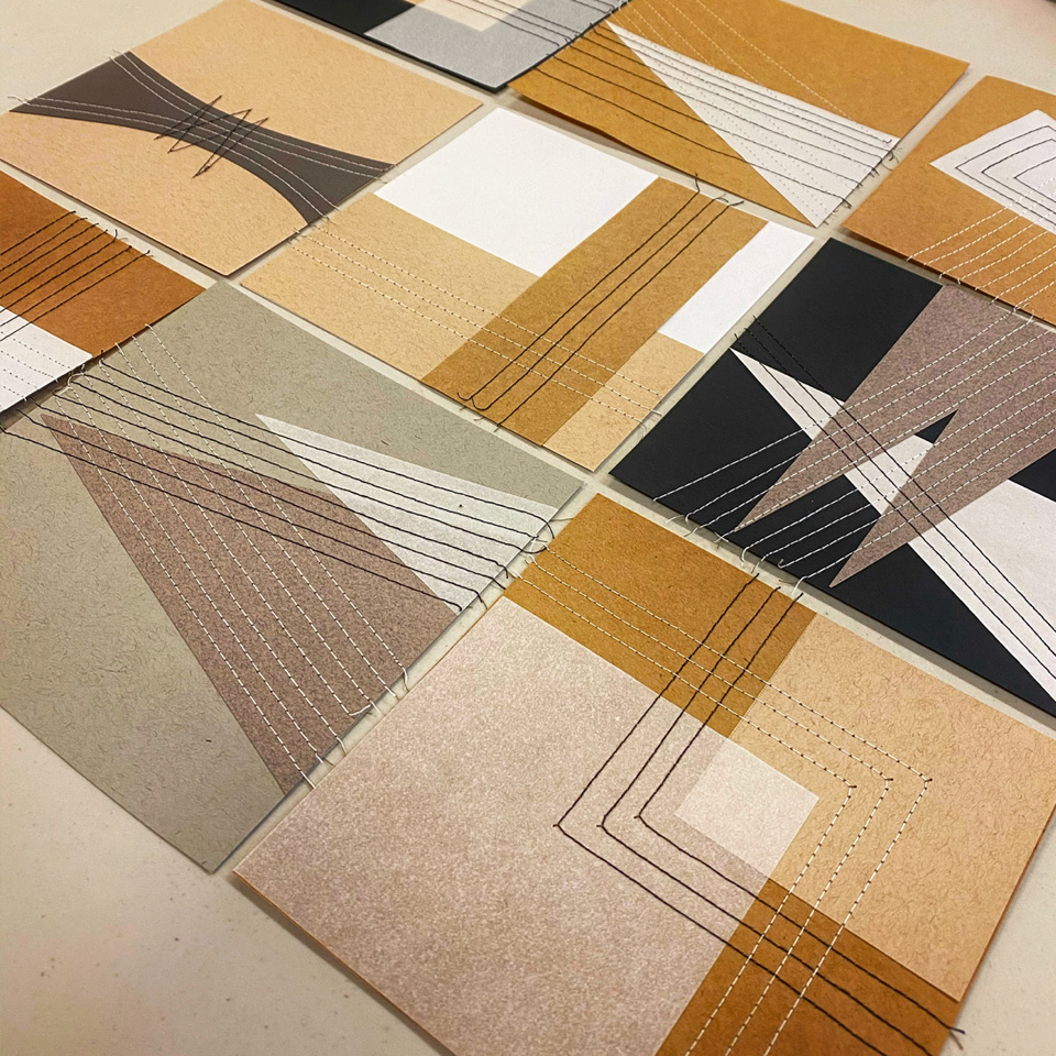 Minimal quilt designs stitched on paper