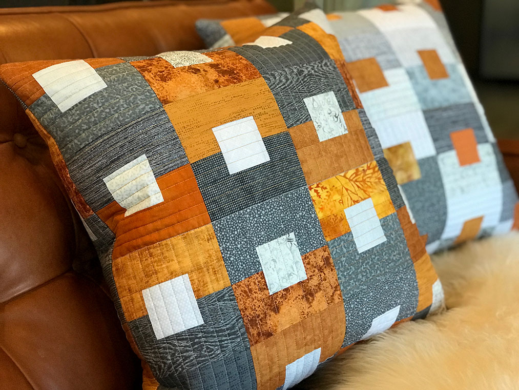 Quilted pillows with square in a square design in rust, grey and white