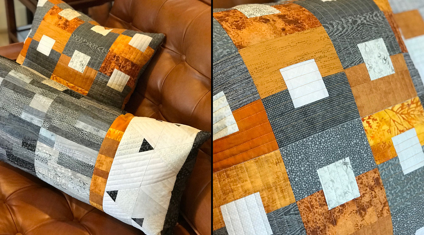 Quilted pillows in grey, rust, and white