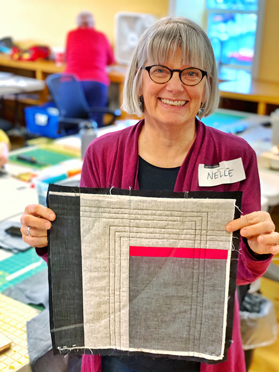 Modern Abstract Quilts workshop participant with her mini quilt
